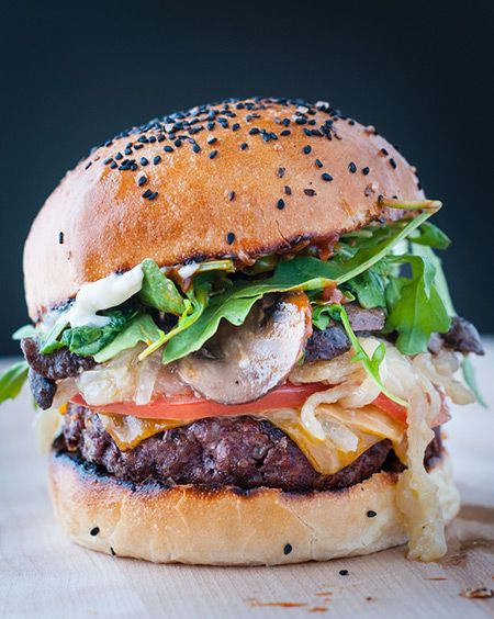 This Epic Beef Burger with a Homemade Brioche Bun is topped with wine ...