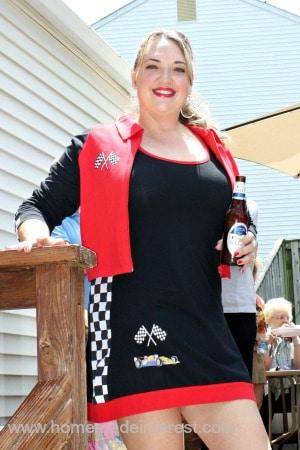 Melinda in a race car costume.