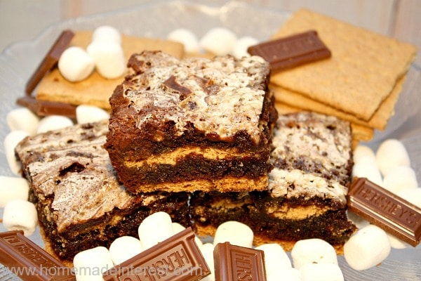 S'mores are amazing and the only thing that could be better is a s'mores brownie! This s'mores brownie recipe starts with a boxed brownie mix and ends with chocolate, graham cracker, and marshmallow deliciousness. Great for camping, parties, or, well, anytime really!