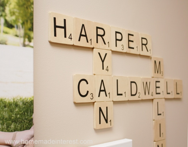 I love the gallery wall in my living room but I wanted to personalize it so I created this simple Scrabble Wall Art that uses the names of my family members. This diy craft was easy to make with the help of my trusty Silhouette Cameo.