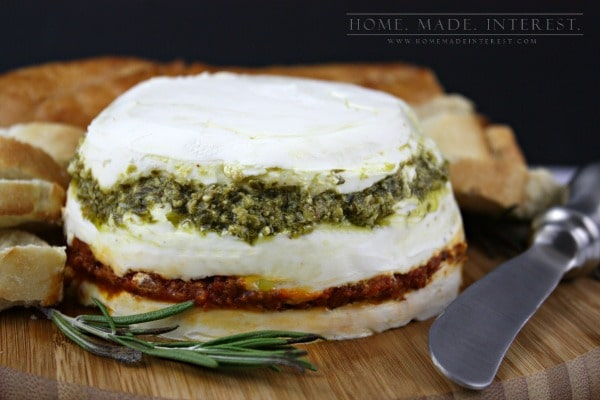 This is one of my favorite appetizers to make and it is always a hit. I've served it at baby showers, bridal showers, birthday parties, dinner parties, holidays parties, you name it this easy recipe is the answer! Made with basil pesto, sundried tomato pesto, goat cheese and cream cheese it is decadent and delicious spread on crostini.