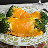 Broccoli Casserole plated with lots of cheese