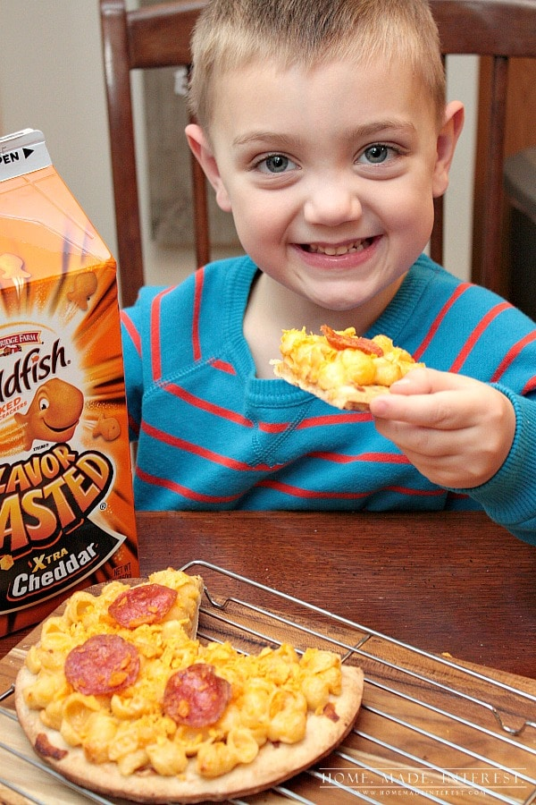 Looking for a different way to serve macaroni and cheese to the kids? Put it on a pizza crust with some pepperoni and you have mac n' cheese pizza! Two of kids' favorite foods in one!
