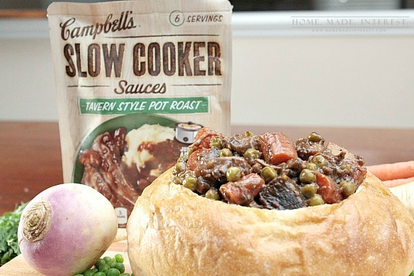 Beef stew in a bread bowl is even better when it is made in a slow cooker. This crock pot beef stew recipe will save you time and warm you up on cold winter nights! #CampbellsSauces