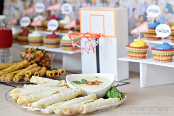 I loved these basketball party ideas. Water bottle sweatbands, DIY game day cupcake toppers, and a spicy queso dip are just a few of the things we used at our basketball playoff party!