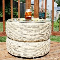 We used sisal rope to create an upcycled table out of used tires and a piece of glass. It is a great table for outside and it was so easy to DIY!