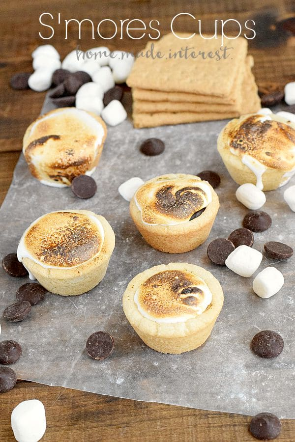 These S'mores cookie cups are filled with chocolate ganache and topped with a roasted marshmallow.