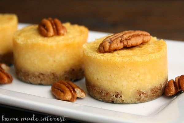 These mini honey pecan cheesecakes are made with sweet honey cheesecake over a pecan crust. They are a great dessert recipes for holiday parties.