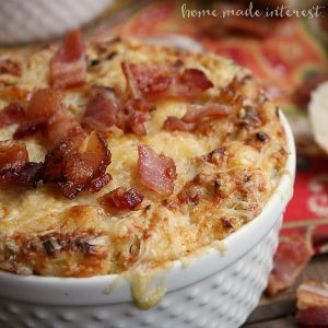 This easy bacon artichoke dip recipe is filled with creamy cheese and smokey flavor. It is a great party appetizer!