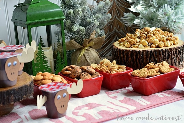 """This Moose Munch Holiday Party is such a fun theme for a holiday party where kids and adults can have a good time. Make your own Moose munch and load up your chocolate """"moose"""" then dig in! We've even got a few moose printables to get you started."""