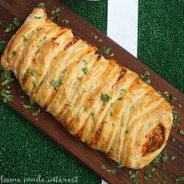 Shredded chicken and cheesy RO*TEL dip braided into a sheet of puff pastry and baked into a delicious chicken taco braid that is the perfect game day recipe for friends and family.