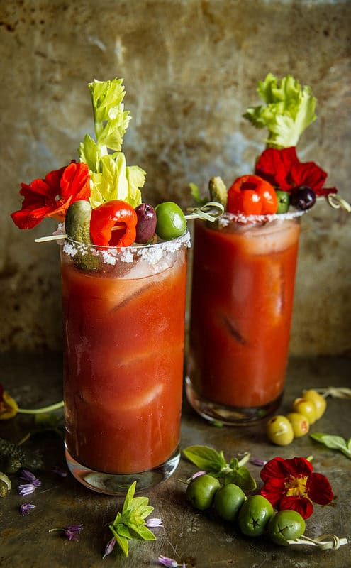 This is the ultimate list of best Bloody Mary mix, drinks, and recipes. Set up a Bloody Mary bar for brunch or even a wedding. Bloody Mary can have just about any garnish!