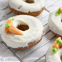 Baked Carrot Cake Donuts | These baked Carrot Cake donuts are frosted with a cream cheese glaze and topped with edible carrots. It is one of the best Easter brunch recipes or Easter dessert recipes. These carrot cake donuts are made with a boxed cake mix and are so easy to make! If you're looking for a sweet Easter brunch recipe you have to try these.
