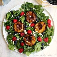 Salads don't have to be boring! I made this summer salad with grilled peaches, fresh berries, crumbled goat cheese, and organic spinach and arugula. My special dressing brings it all together for a healthy summer dinner recipe that is super easy to make!