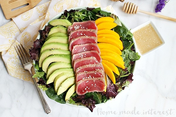 This light and fresh seared tuna salad is a healthy lunch option mixed with mangoes and avocados and topped with a Miso vinaigrette.