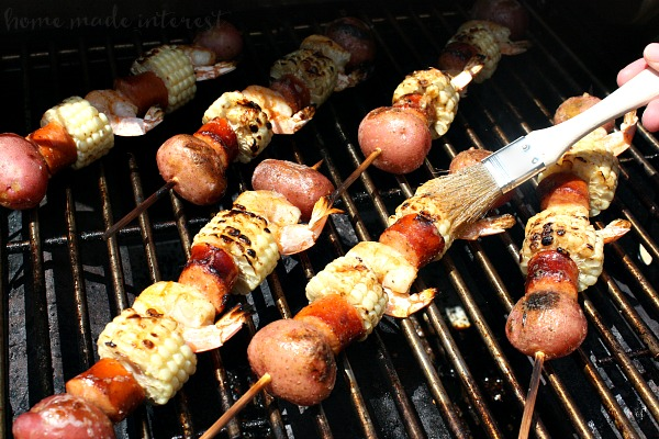 These easy Shrimp Boil Kebabs take all of the ingredients of a traditional shrimp boil recipe and put them on a skewer so they can be grilled. Basted in butter and Old Bay seasoning these delicious kabobs are perfect grill recipe for a summer party!