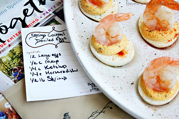 Shrimp cocktail deviled eggs are a new twist on two retro classics. This simple appetizer combines shrimp cocktail and deviled eggs for an updated vintage appetizer recipe that is perfect for retro parties!
