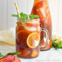 We've spiked this peach sweet tea with some peach vodka and filled it with frozen peaches for a summer cocktail recipe that is perfect for sipping out on the porch with friends after a long week.