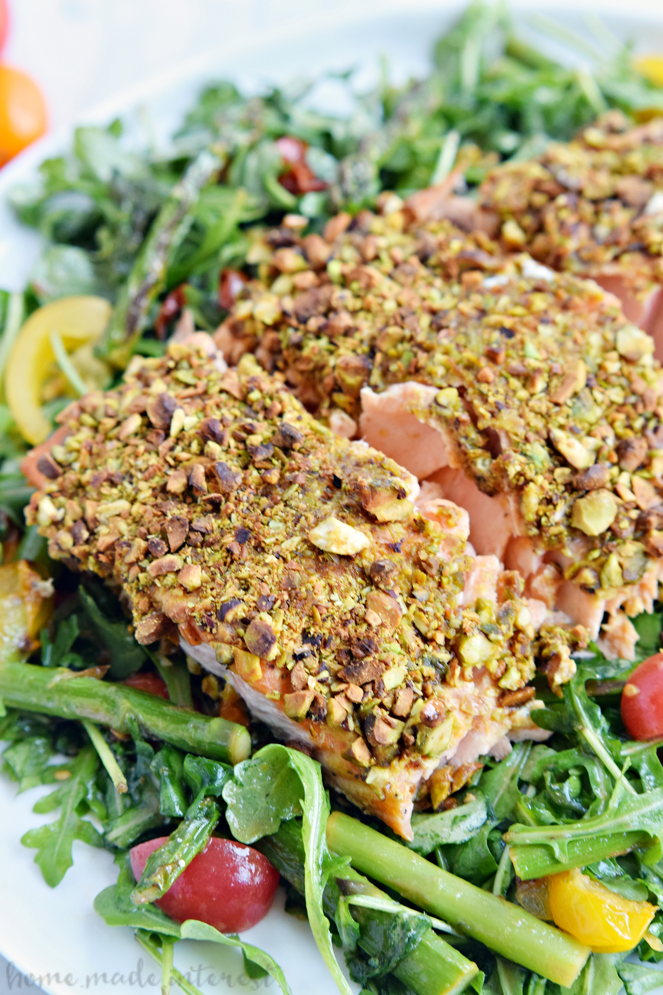 This Pistachio Crusted Salmon recipe is elegant enough for a dinner party and makes an easy weeknight dinner recipe. Pistachio and Dijon mustard pair together perfectly in this healthy low carb recipe.