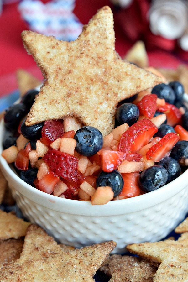 Blueberries, apples, and strawberries make up this light and fresh summer fruit salsa. It is perfect side dish or dessert recipe for Memorial Day, 4th of July, and Labor Day cookouts with it's beautiful red, white, and blue colors and served with crisp, sweet, cinnamon chips shaped like stars.