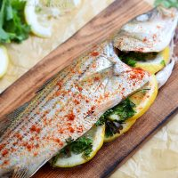 Cedar Plank Grilled Fish is a grilled whole fish full of flavor. This is an easy fish recipe with a lightly seasoned fish grilled on a cedar plank over and open flame. The result is a smokey flavor that will have everyone asking for seconds. Try this easy grilled seafood recipe the next time you fire up the grill.