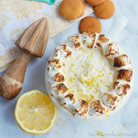 This fluffy Lemon Meringue Dip is a mix of meringue and lemon curd served with graham crackers or cookies. It is a no bake summer dessert that you can enjoy all year long! Take it to your next summer potluck or make it for your friends at your next party.