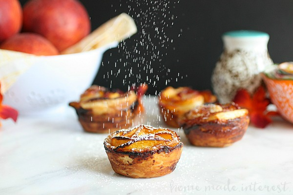 All of the flavors of a peach tart rolled up into beautiful peach rose cups. Puff pastry and fresh peaches and rolled up to create sweet peach roses. This is the perfect summer peach recipe!