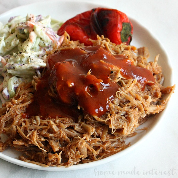 Make BBQ pulled pork in half the time with this easy Pressure Cooker Pulled Pork recipe. If you have an Insta-pot or any pressure cooker this pulled pork recipe is for you! Just put the pork and sauce in the pressure cooker, set and forget. When the timer goes off you have tender BBQ pulled pork that is perfect for sandwiches and sliders!