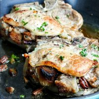These delicious Apple Pecan Stuffed Pork Chops are an easy dinner recipe that everyone in the family will love. The pork goes perfectly with the Apple Pecan Stuffing and it adds so much flavor to the meat. Serve this apple pecan stuffed pork chops recipe with a big helping of mashed potatoes!