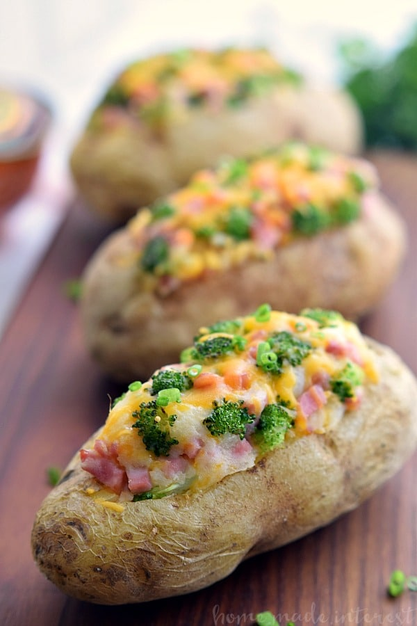 These ham and broccoli twice baked potatoes are stuffed with cheese, ham, and broccoli all put back into a potato shell and baked a second time. This easy twice baked potato recipe is a full meal and kids and adults will love it!