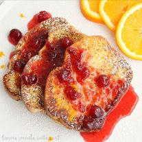 There are lots of family breakfasts and brunches during the holidays. Whether it is a Christmas brunch recipe or a Christmas breakfast recipe...or maybe a New Year's brunch recipe that you are looking for this cranberry orange french toast recipe is going to have everyone asking for seconds. This easy french toast is topped topped with a simple orange cranberry syrup that gives it a sweet and tart flavor that is amazing! Sprinkle a little powdered sugar and you've got the best french toast recipe ever!