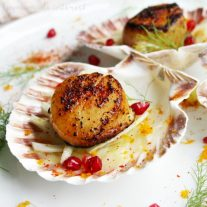 This Red Chili Seared Scallops recipe is an an elegant appetizer recipe that will make a great addition to your New Year's Eve holiday appetizers. The scallops are coated in Basque Red Chili Powder for a warm sweet flavor that pairs perfectly with the fresh Citrus Fennel Salad it is served on. It's an easy seafood appetizer recipe is sure to impress your friends and family with its beauty and simplicity.