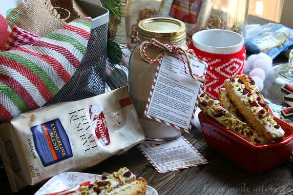 On Christmas morning we wake up early and nothing makes me happier than a big cup of coffee and a homemade Cranberry pistachio biscotti. This easy biscotti recipe can be made ahead of time and it is coated in white chocolate, dried cranberries, and pistachios. I'm loving this easy Christmas basket tutorial, with ideas for creating a Christmas Morning Coffee and Biscotti gift basket with homemade biscotti mix! If you need a Christmas gift idea for a coffee lover this is perfect!