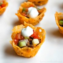 These low carb taco cups are an easy low carb recipe that can be a low carb appetizer for Christmas or New Year's or just a quick healthy lunch for those on a low carb diet. The cheesy shells are perfect for all of that taco goodness inside. These will disappear quick!
