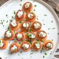 These Mini Crab Cake Bites are an easy appetizer recipe for Christmas or New Year's Eve. This elegant bite size appetizer is a mini crab cake served over cheddar cheese on a Ritz cracker. Enjoy these crab cakes along with several other seafood appetizers for your New Year's Eve party.