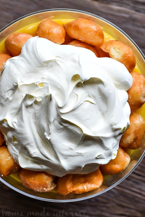 Donut Trifle   This decadent dessert recipe uses Krispy Kreme doughnuts to make an easy trifle recipe. Layers of whipped cream, vanilla pudding and donut holes makes an easy donut trifle recipe that everyone is going to love. Trifle is an easy dessert recipe for the holidays and it would make a great potluck dessert recipe for summer picnics.