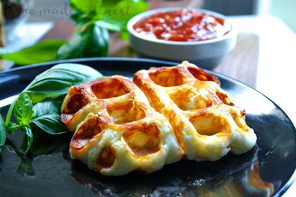 This Low Carb Cheese Waffle is made from gooey Halloumi cheese. Enjoy cheese waffles topped with your favorite low carb tomato sauce as a low carb cheese stick substitute. This is an easy low carb appetizer that totally fills that fried cheese craving!