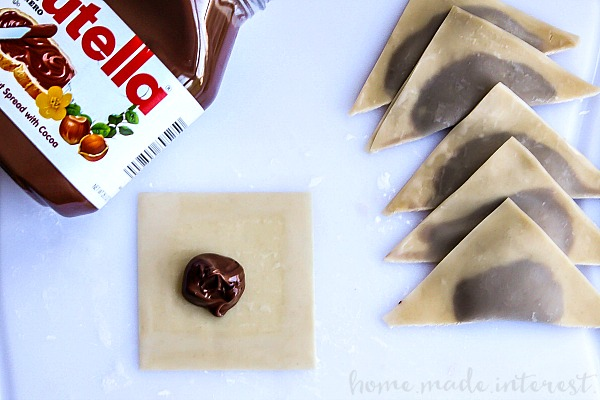 Uncooked Nutella wontons filled with Nutella and ready to go in the fryer.