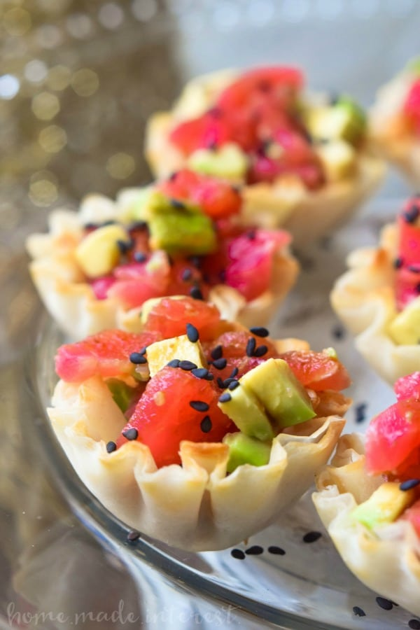 New Year's Eve sushi appetizer with tuna, and avocado in a phyllo cup