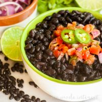 Pressure Cooker Black Beans and Chorizo | Cooking dry black beans has never been easier! We'll show you how to cook dry black beans in a pressure cooker along with delicious spanish chorizo for a flavor that you're going to love. Pressure cooker black beans are quick and easy and perfect served over rice with a little pico de gallo. It's a black bean recipe that beats baked beans any day!