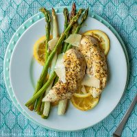 Sheet Pan Lemon Chicken and Asparagus | This easy sheet pan meal is perfect for spring or summer. Bright, fresh asparagus and chicken tenders baked on a sheet pan over lemon slices giving everything a light, fresh flavor. This Sheet Pan Lemon Chicken and Asparagus is a quick and easy weeknight dinner recipe that is great if you are looking for healthy dinner recipes.