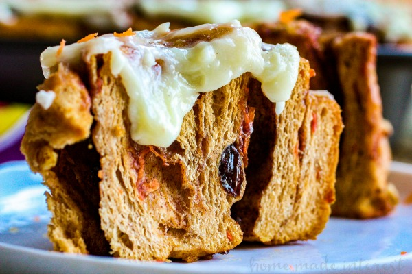 Carrot Cake Cinnamon Rolls | Who wants carrot cake for breakfast? This is one of the best Easter brunch recipes you're going to find. This recipe for carrot cake cinnamon rolls is an easy Easter brunch recipe. Filled with raisins, carrots, and cinnamon and topped with cream cheese frosting these carrot cake cinnamon rolls are amazing!