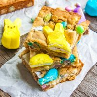 Easter Candy Blondies | Looking for something to do with all of that leftover Easter candy? This easy blondie recipe uses Peeps along with all of your other favorite Easter candy to make Easter Candy Blondies. If you're looking for a fun Peeps recipe you're going to love this! This Easter dessert recipe is so good and so simple to make!
