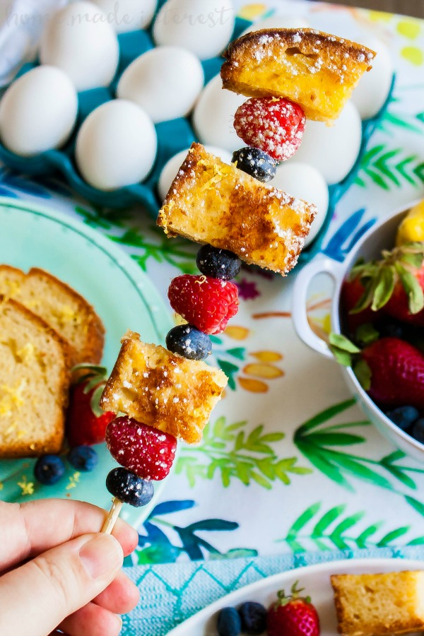 lemon pound cake french toast with fresh berries on a skewer