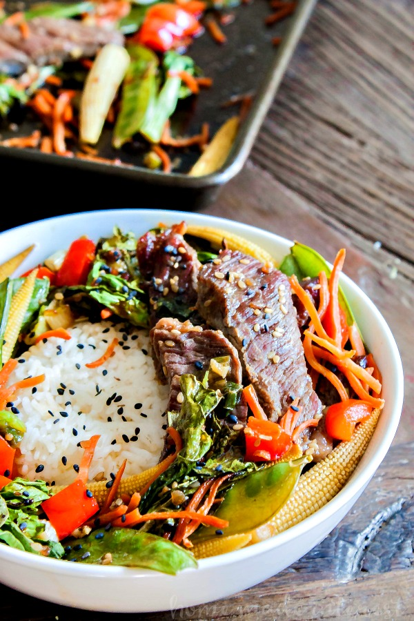 Sheet Pan Beef Teriyaki | This easy sheet pan meal is an easy weeknight dinner recipe that takes less than 30 minutes to make. Sheet pan beef teriyaki recipe is thin slices of beef tossed in teriyaki sauce and baked with asian vegetables. Serve this easy sheet pan dinner recipe over rice or noodles for a quick and easy dinner.
