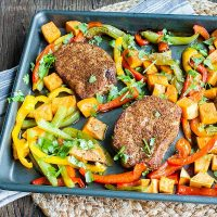 Sheet Pan Spicy Pork Chops and Sweet Potatoes | Sheet pans meals are so popular right now and they are such a great way to make a quick and easy dinner. These spicy pork chops and sweet potatoes are full of flavor and make a bright and beautiful weeknight dinner. This pork chop sheet pan meal is tossed with pepper, onions, and sweet potatoes for a sheet pan dinner that everyone will love.