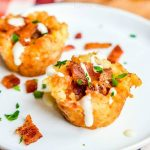 Loaded Tater Tot Bites | This awesome tater tot appetizer recipe is and easy game day appetizer that is perfect football party food. Loaded Tater Tot Bites are filled with everything you love in a loaded baked potato. Tater tot cups with bacon, cheese, sour cream. It is the best potato appetizer!