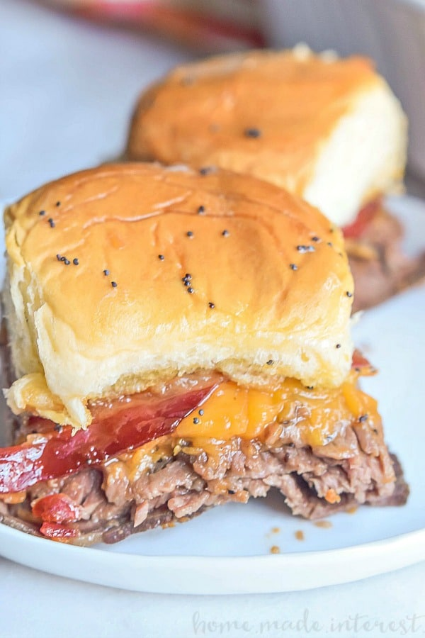 Bourbon Bacon Roast Beef Sliders   These Bourbon Bacon Roast Beef Sliders are an easy slider recipe that makes a great game day recipe! Make these bourbon bacon roast beef sliders for your next football party or summer party appetizer! Make this quick and easy weeknight dinner recipe for your family and impress your guests with this easy appetizer recipe.