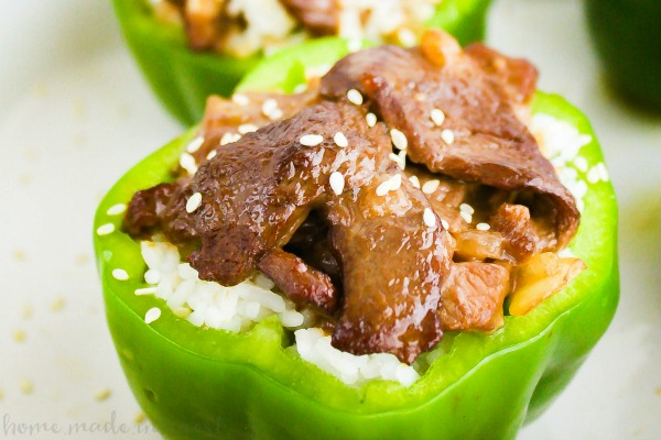 Pepper Steak Stuffed Peppers | This easy weeknight dinner recipe takes the fun of stuffed peppers and fills them with the rich flavors of a Chinese Take-out favorite, pepper steak. Pepper steak stuffed peppers are beef strips marinated and tossed in a soy-ginger sauce and served in baked peppers is a pepper steak recipe the whole family is going to love.