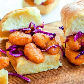 Bang Bang Shrimp Sliders | These easy Bang Bang Shrimp Sliders are sweet and spicy and full of flavor. They take a delicious copycat Bang Bang Shrimp recipe and put it on a slider bun with a cool and crisp red cabbage slaw. This is an amazing appetizer recipe that is an easy party appetizer or a quick and easy weeknight dinner idea.